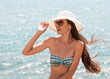 Beach woman laughing having fun in summer vacation holidays.