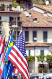 Limone del Garda-Flags on lakeshore color image poster