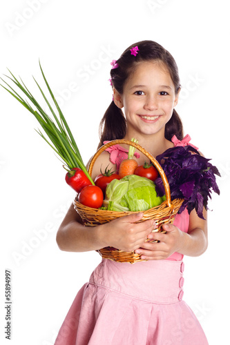 Smiling girl with vegetables