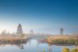 morning sunshine over misty swamp