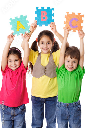 Three kids with letters