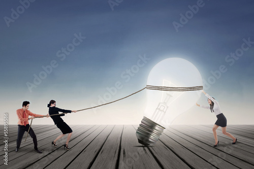 Business team pulling lamp outdoor