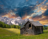 Shack on a mountain meadow - Sunset with fields and peaks