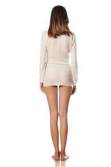 Rear view of pretty skinny girl dressed only in a white sweater