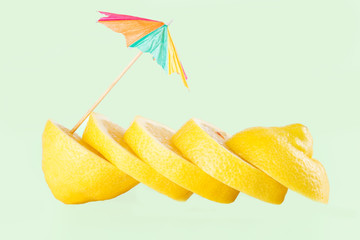 Row of juicy yellow lemon sliced wheels with straw