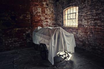 corpse under sheet