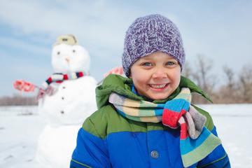 Boy makes a snowman