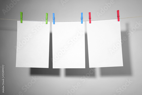 White paper on clothespins. Clipping path in file
