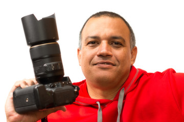 Photographer holding a camera on his hand