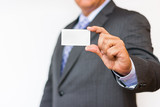 Business man showing an empty business card