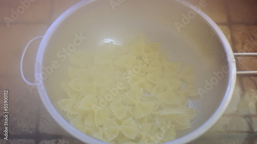 Italian pasta strained in kitchen sink