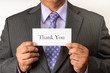 Business man holding thank you sign