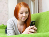 girl uses mobile in home