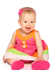 happy little baby girl in bright multicolored festive dress isol