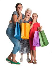 Three generations of women with shopping bags