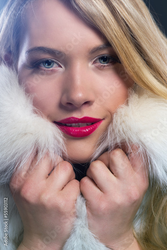 canvas print picture attraktive blonde woman in a warm winter coat