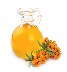 branch of sea-buckthorn and oil