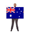 Smiling businessman holding a big card, flag of Australia