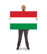 Smiling businessman holding a big card, flag of Hungary