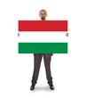 Smiling businessman holding a big card, flag of Hungary