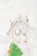 wooden house christmas decoration on white snow background