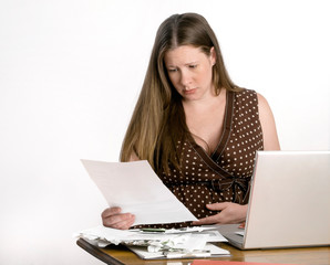Pregnant Worried Young Woman Reading Bills at Laptop Computer