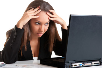 Worried Woman Looking At A Computer Monitor