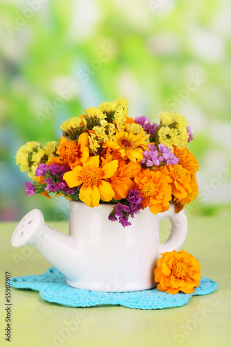 Bouquet of marigold flowers in watering can