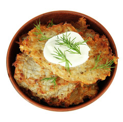 Potato pancakes in bowl, isolated on white