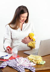 Pregnant Woman Shopping for Baby Supplies on Internet