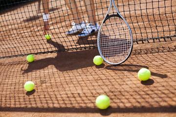 Tennis racket and balls, tennis court