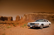 Classic car in the desert of Monument valley