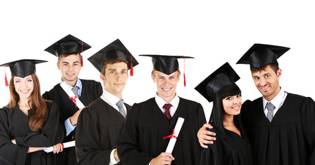Young graduates isolated on white