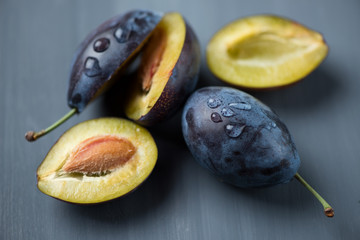 Still life fruits: plums, studio shot