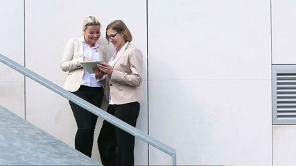 Two business women looking at tablet PC