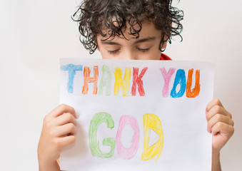 Hispanic child holding a religious sign