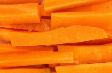 Background of fresh carrots sticks.