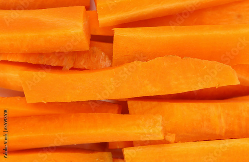 Background of fresh carrots sticks.