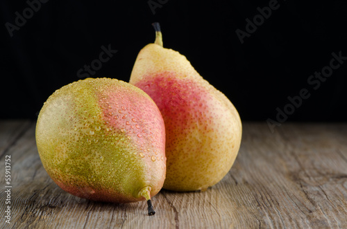 Pears in a old wooden table