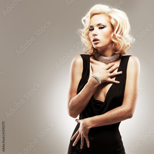 Beautiful sexy white woman in black dress