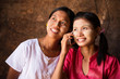 Two Myanmar girls using smart phone.