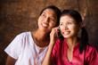 Two Myanmar girls using smart phone.