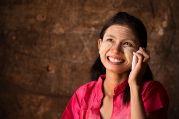 Myanmar girl using smart phone.