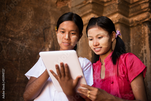 Myanmar girl using digital tablet pc