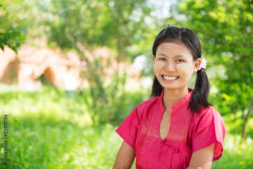 Myanmar girl standing outdoor.