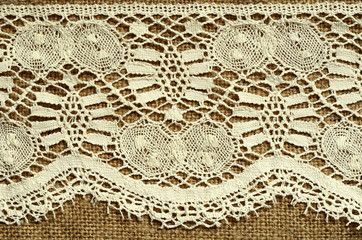 Canvas background with white lace