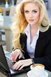 Young pretty business blonde woman with notebook