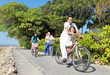 Happy asian family riding bikes in the beautiful morning at the