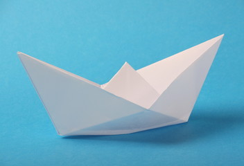 Origami Paper Boat on a Blue Background