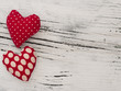 textile hearts on the wooden background